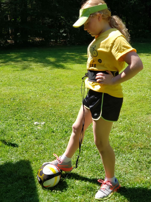 Elora playing soccer outside
